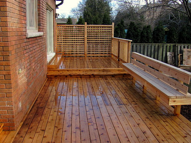 custom design and construction of cedar deck with build in siting bench - building outdoor decks Vaughan