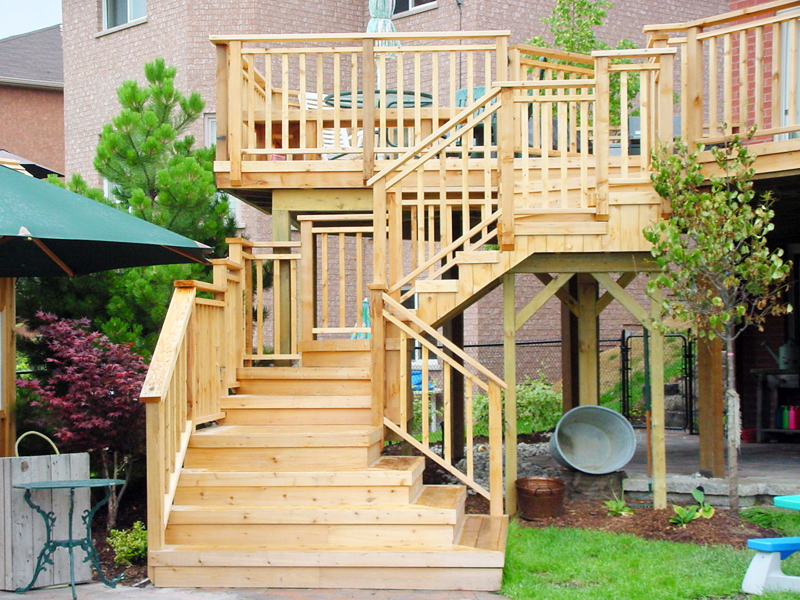 luxury multilevel wooden deck and amazing landscaping - walk out decks designs Woodbridge