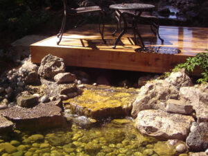 custom deck and small waterfall underneath it - Pergolas Design