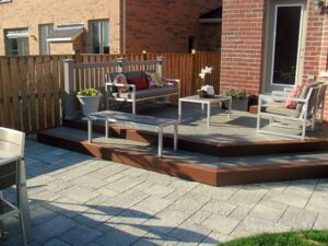 custom deck from stone with table and chairs - Deck Builders Toronto