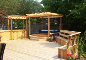 custom backyard deck with build in bench and pergola with build in tub - pergolas on decks