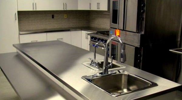 custom kitchen renovation with metal counter top - carpentry