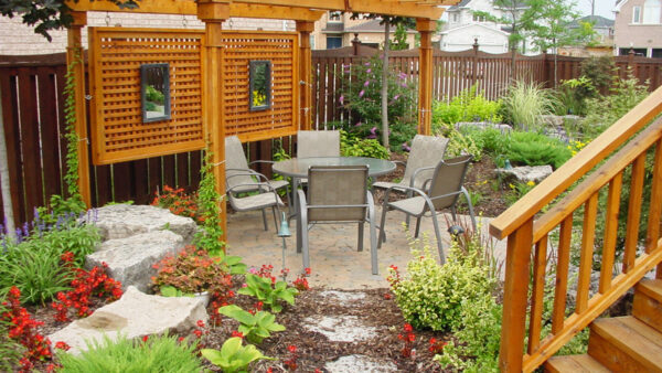 backyard pergola with chair and table - Pergola Builders Toronto