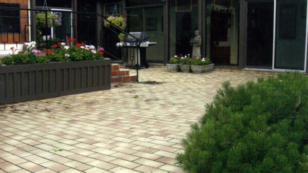 interlocking backyard with stone pathway and treas - Pergola Builders Toront