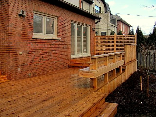 custom outdoor deck with wooden railings and stairs deck design companies Richmond Hill