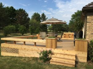 custom deck in the backyard with stairs - deck contractors toronto