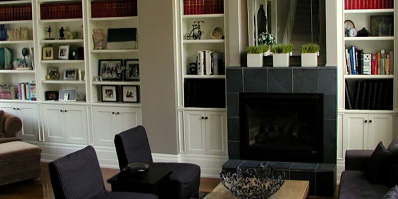 luxury living room with fireplace and book shelf - Pergola Builders Toronto