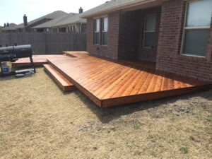 custom wooden deck and a grill in the backyard - outdoor decks