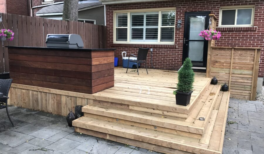 backyard deck with grill on it and stone interlocking - decking company