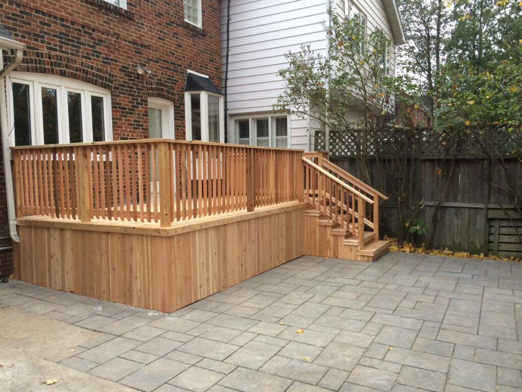 custom deck with wooden railings and staircase - deck contractors Woodbridge