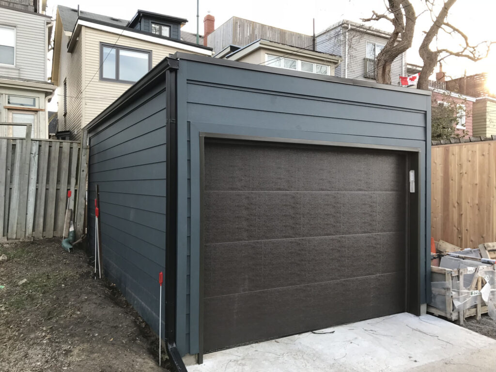 backyard blue garage addition - Pergola Builders Toronto