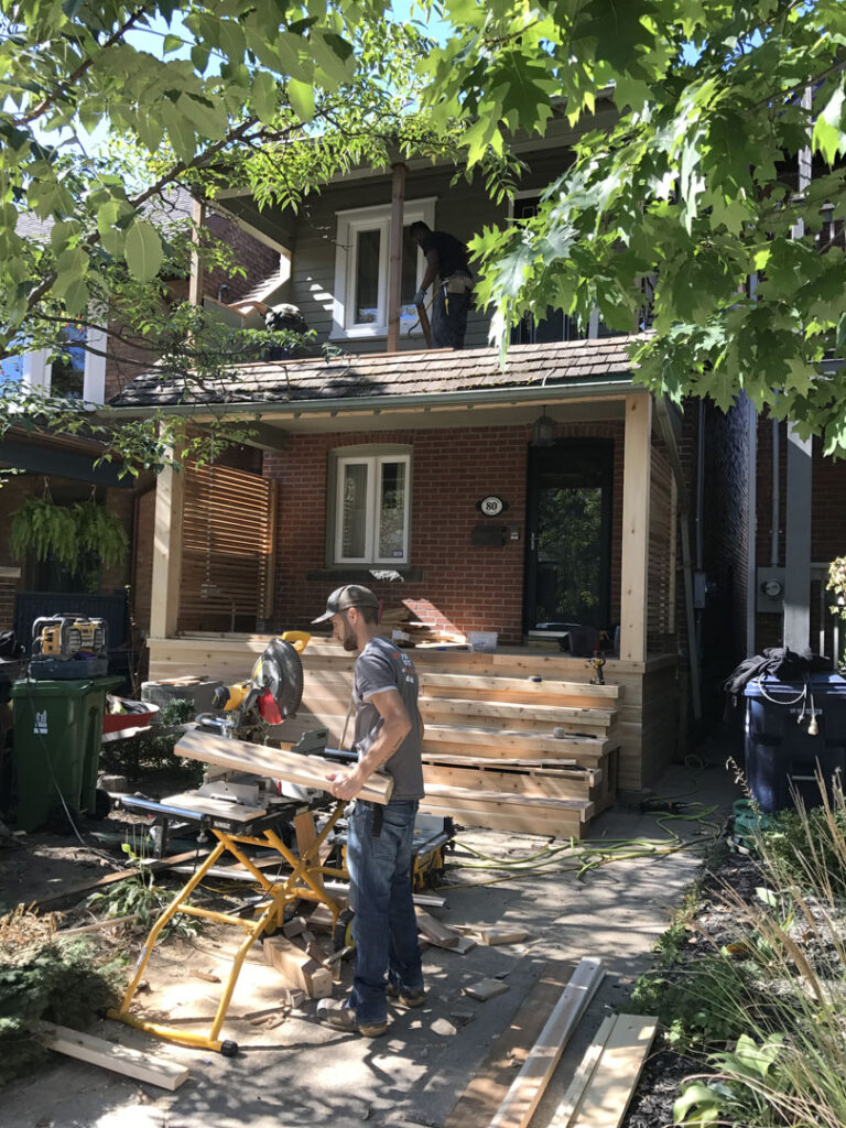 in progress of building custom porch by living construction