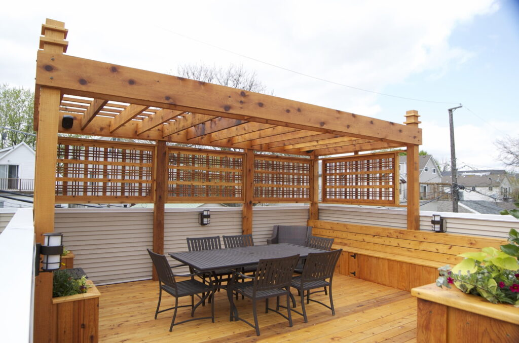 custom Pergola with brown chairs and table Woodbridge