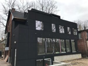 custom home with black paint - home addition