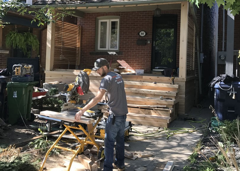 living construction team working on front porch - backyard decks